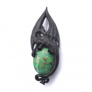 Dragon brooch in bog oak and turquoise
