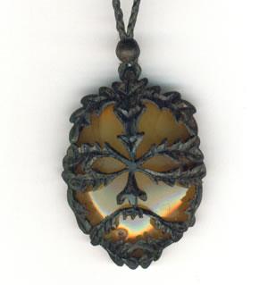 Green man pendant in bog oak and amber