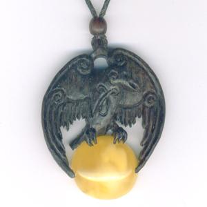 Raven pendant in bog oak and amber