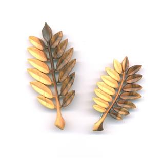 kilt pin and brooch in rowan
